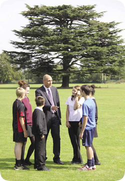 Headteacher with students